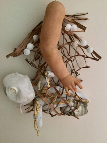 Now - plastic doll arm, fabric doll form, chicken bones, leather baby shoes, bottle caps, expandable protective straw bottle sleeve