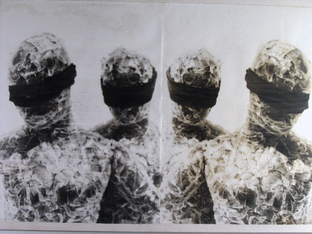 """""""Hostage: #20 (2x)"""" – hand coated silver emulsion on BFK Rives, 44"""" x 30"""". It is the nature and beauty of a hand coated silver emulsion print to have steaks and discoloration."""